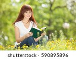young woman reading a book in... | Shutterstock . vector #590895896