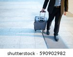 business man and suitcase | Shutterstock . vector #590902982