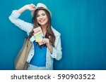 woman traveler holding passport ... | Shutterstock . vector #590903522