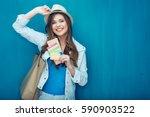 woman traveler holding passport ... | Shutterstock . vector #590903522