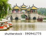 Landscape View of Five Pavilion Bridge on Cloudy Rainy Day, Slender West Lake , Yangzhou, China