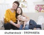 grandmother and grandchildren... | Shutterstock . vector #590944856