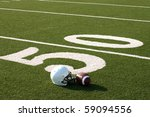 american football and helmet on ... | Shutterstock . vector #59094556