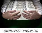 Small photo of Businessman embrace 1 million US dollars in his arm.