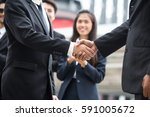 businessmen handshaking after... | Shutterstock . vector #591005672