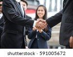 businessmen handshaking after... | Shutterstock . vector #591005672
