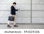 young man using smart phone... | Shutterstock . vector #591025106