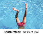 teenager has fun in water park. ... | Shutterstock . vector #591075452