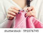 The Woman Knits Woolen Clothes. ...