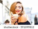 young pretty woman enjoying ... | Shutterstock . vector #591099812