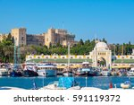 boats in mandraki harbour.... | Shutterstock . vector #591119372