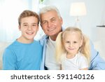 cute children with grandfather... | Shutterstock . vector #591140126
