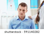 man visiting doctor at hospital | Shutterstock . vector #591140282