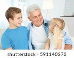 cute children with grandfather... | Shutterstock . vector #591140372