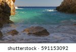 Small photo of Photo of Karpathos island rocky beach with turquoise waters, Dodekanese islands, Aegean, Greece