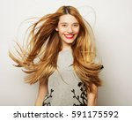 beautiful young surprised woman.... | Shutterstock . vector #591175592