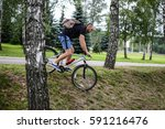 portrait man cyclist riding in... | Shutterstock . vector #591216476