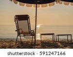 beach chair and beach umbrella  ... | Shutterstock . vector #591247166