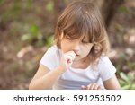 funny thoughtful girl gnaws... | Shutterstock . vector #591253502