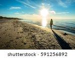 beautiful woman on sunset beach....