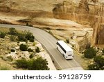 A Tour Bus Drives Through The...