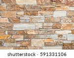 stone wall of natural stones in ... | Shutterstock . vector #591331106