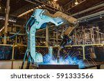 robot welding auto part in... | Shutterstock . vector #591333566