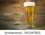 beer on background wooden wall | Shutterstock . vector #591347852