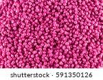 pink plastic pellet | Shutterstock . vector #591350126