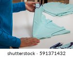 at a garment factory quality... | Shutterstock . vector #591371432