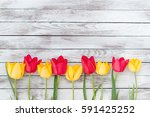 Colorful Tulips On The Wooden...