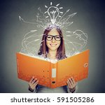 happy woman reading a book  | Shutterstock . vector #591505286