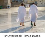 muslim wearing ihram clothes... | Shutterstock . vector #591510356