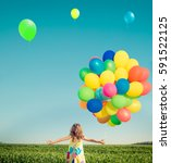 happy child playing with bright ... | Shutterstock . vector #591522125