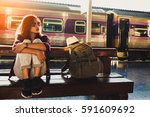 young woman traveler wearing... | Shutterstock . vector #591609692