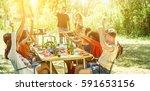 happy friends having fun eating ... | Shutterstock . vector #591653156