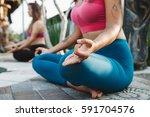 young women practicing yoga...   Shutterstock . vector #591704576