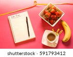 diet plan book with pen on the... | Shutterstock . vector #591793412