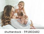 mother with children  | Shutterstock . vector #591802682