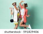 two happy women   best friends... | Shutterstock . vector #591829406
