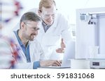 handsome chemists with laptop... | Shutterstock . vector #591831068