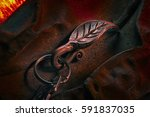 forged key chain bronze key on... | Shutterstock . vector #591837035