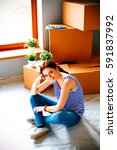 woman in a new home with... | Shutterstock . vector #591837992