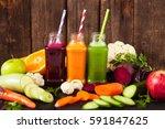 freshly squeezed vegetable... | Shutterstock . vector #591847625