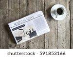 newspaper on wooden table | Shutterstock . vector #591853166
