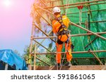 workers wearing safety harness... | Shutterstock . vector #591861065