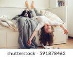 happy kid girl waking up in the ... | Shutterstock . vector #591878462