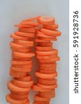 stacks of sliced carrots closeup | Shutterstock . vector #591928736
