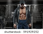 muscular man with open jacket... | Shutterstock . vector #591929252