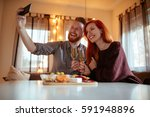 shot of a young happy couple... | Shutterstock . vector #591948896